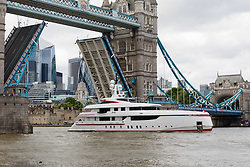"© Licensed to London News Pictures. 16/06/2018. London, UK.  Bruce Grossman's 180 feet long superyacht, Forever One sails on the River Thames in London passing under Tower Bridge. Bruce Grossman is one of the richest men in Mexico (estimated net worth of USD1.5 billion) and shareholder of Arca Continental, the second largest Coca-Cola bottler in Latin America and third largest in the world. The unusual red colour scheme of the yacht reflects Grossman's significant Coca-Cola business interests and the yacht also features a reverse bow, fold-down balconies and a beach club with large window in the transom. The name Forever One refers to Bruce's wife Elsa, the childhood best friend of his younger sister and who later became Grossman's ""forever one""..  Photo credit: Vickie Flores/LNP"