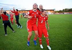 NEWPORT, WALES - Tuesday, June 12, 2018: Wales' L-R Natasha Harding, Jessica Fishlock and Loren Dykes celebrate at the final whistle after beating Russia 3-0 during the FIFA Women's World Cup 2019 Qualifying Round Group 1 match between Wales and Russia at Newport Stadium. (Pic by David Rawcliffe/Propaganda)
