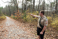 Thomas Hayes shows the area of the trail where he widened and added gravel as part of his Eagle Scout project in the Jeff Marden Forest in Belmont.  (Karen Bobotas/for the Laconia Daily Sun)