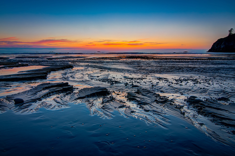 A spectacular sunset at Washington's Ruby Beach. These wild formations in the sand are what remains when Cedar Creek empties directly onto the beach, and the freshwater runoff washes the softer sand and silt into the surf creating these amazing miniature canyons and washes. Next low tide, a whole new micro-landscape will be created.