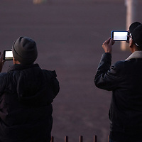 Brothers Tony Ashley, left, and Melvin Ashley ready their phones to capture the launch of a Black Dagger target missile from the Fort Wingate Army Depot Thursday morning at Red Rock Park in Churchrock.