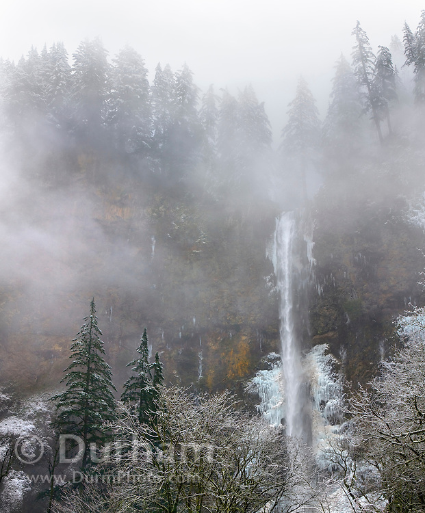 The top portion of Mutnomah Falls during winter in Columbia River Gorge National Scenic Area, Oregon.