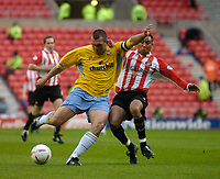 Photo. Glyn Thomas, Digitalsport<br /> NORWAY ONLY<br /> <br /> Sunderland v Crystal Palace. <br /> Division 1 Playoffs, second leg. 17/05/2004.<br /> Palace's Neil Shipperley sends in an early shot on goal despite the attentions of Sunderland's Jeff Whitley.