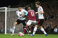 Chris Smalling of Manchester United and Daley Blind of Manchester United intercept Enner Valencia of West Ham United. The Emirates FA cup, 6th round replay match, West Ham Utd v Manchester Utd at the Boleyn Ground, Upton Park  in London on Wednesday 13th April 2016.<br /> pic by John Patrick Fletcher, Andrew Orchard sports photography.