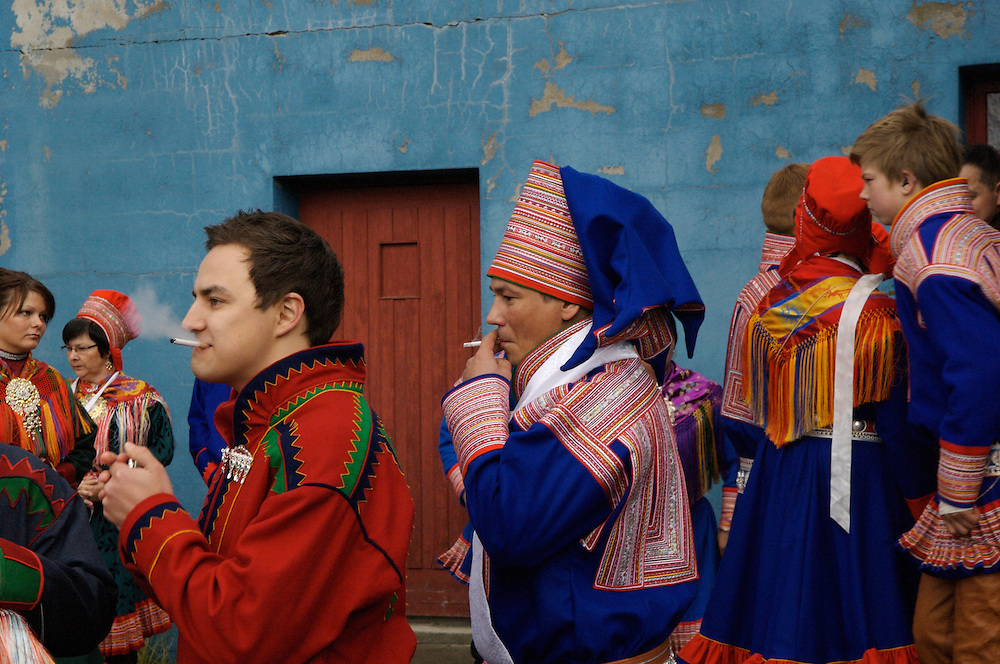 The Sami groom (center) smokes a cigarette after his wedding in Kautokeino, Norway.