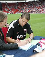 Photo: Lee Earle.<br /> Southampton v Panathinaikos. Pre Season Friendly. 29/07/2006. Southampton's latest player Rudi Skacel signs forms just before kick off.