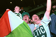 Celtic fans wave an Irish tricolour flag at Parkhead, Glasgow.