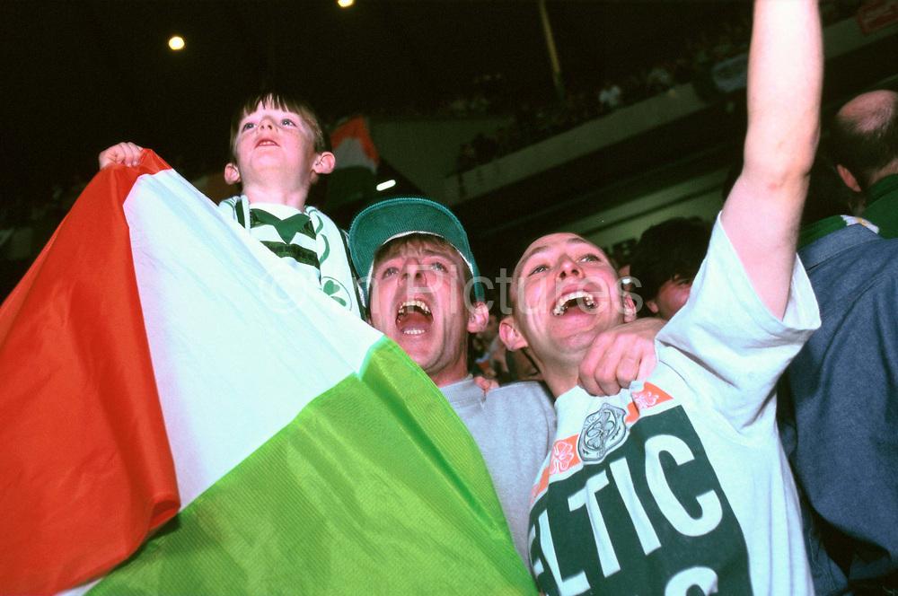 Celtic fans wave an Irish tricolour flag at Parkhead, Glasgow.