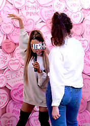 Grace takes pictures of the waxwork of Ariana Grande at the unveiling of Ariana Grande's wax figure at Madame Tussauds, London.