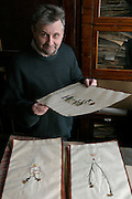St Petersburg, Russia, 10/02/2004..Founded in 1714 by Peter the Great, the Komarov Institute is one of the largest botanical collections in the world. Dr Andrei Sutin with part of Dr Abraham Ens' herbarium, or dried plant collection, circa 1745.