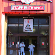 Staff at the factory look on as members the Scottish Resistance are heckled outside Tunnocks Factory in Uddingston to demonstrate their opposition to the removal of the lion rampant from the famous brand teacakes which are manufactured in the factory behind them. Picture Robert Perry 14th Jan 2016<br /> <br /> Must credit photo to Robert Perry<br /> FEE PAYABLE FOR REPRO USE<br /> FEE PAYABLE FOR ALL INTERNET USE<br /> www.robertperry.co.uk<br /> NB -This image is not to be distributed without the prior consent of the copyright holder.<br /> in using this image you agree to abide by terms and conditions as stated in this caption.<br /> All monies payable to Robert Perry<br /> <br /> (PLEASE DO NOT REMOVE THIS CAPTION)<br /> This image is intended for Editorial use (e.g. news). Any commercial or promotional use requires additional clearance. <br /> Copyright 2014 All rights protected.<br /> first use only<br /> contact details<br /> Robert Perry     <br /> 07702 631 477<br /> robertperryphotos@gmail.com<br /> no internet usage without prior consent.         <br /> Robert Perry reserves the right to pursue unauthorised use of this image . If you violate my intellectual property you may be liable for  damages, loss of income, and profits you derive from the use of this image.