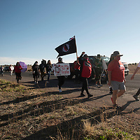 A large group walks six miles from the Navajo Nation Council Chambers in Window Rock, Arizona to Tséhootsooí Middle School in Fort Defiance, Arizona Wednesday, May 5 in honor of Missing and Murdered Indigenous Persons Awareness Day. Tséhootsooí Middle School was the last place Laverda Guy Sorrell was seen in 2002 before she went missing.