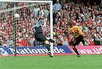 Kenny Miller (Wolves)  scores goal no.3 past goalkeeper Paddy Kenny. Wolverhampton Wanderers v Sheffield United. Division One play off Final @ Cardiff's Millennium Stadium. 26/5/2003. Credit : Colorsport/Andrew Cowie.