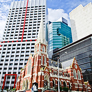 Old and new architecture in Brisbane City with Albert Street United Church in the foreground
