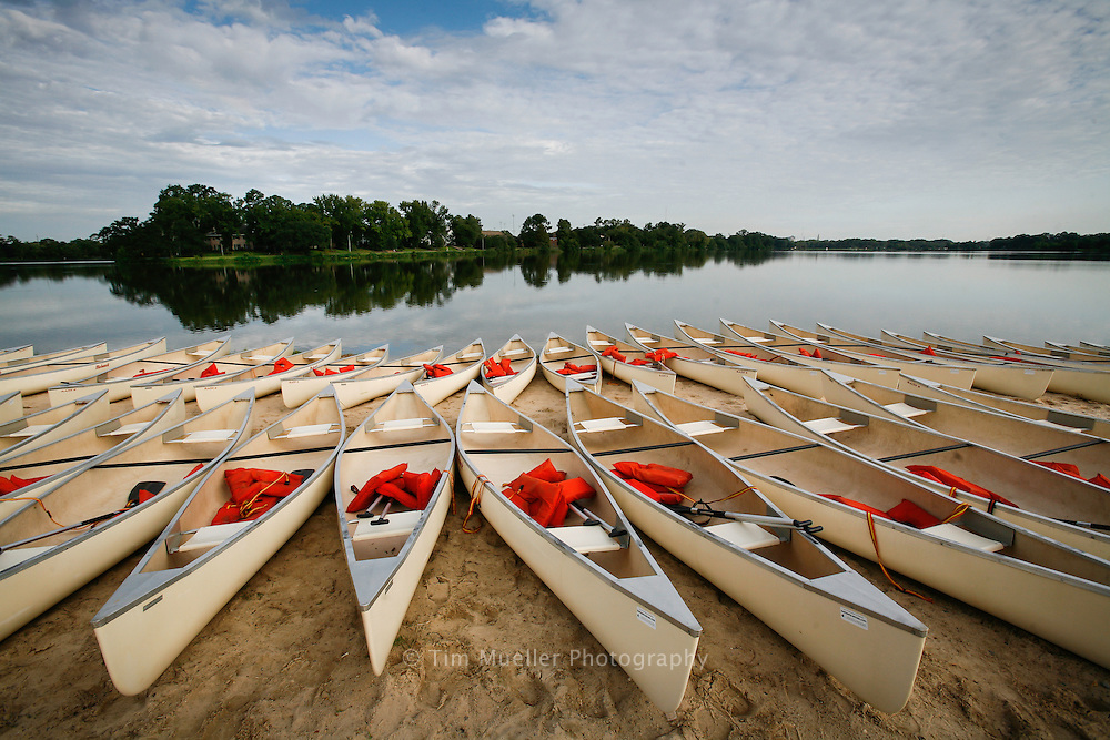 Urban Adventure Race canoes are lined up along the sand beach at  BREC's Milford Wampold Memorial Park located on Stanford Avenue, on the LSU Lake in Baton Rouge, La.
