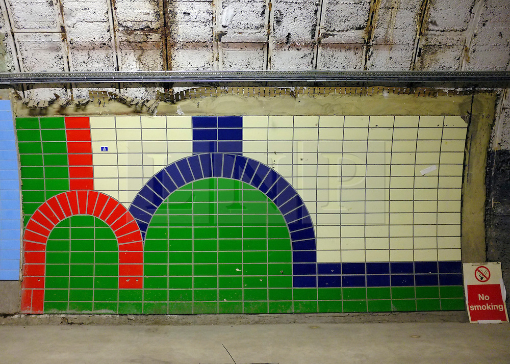 © Licensed to London News Pictures. 02/12/2012. London, UK Here an area of wall was used to test the tile design currently used at Piccadilly Station. London Transport Museum held tours, today 2nd December 2012, of Aldwych Tube Station, one of London's closed underground stations. Visitors were give a rare chance to glimpse what happens to a station after the public leave. The tour included a platform closed in 1914 which was used as a store for the National Gallery during the 2nd World War, amongst items stored were the Elgin Marbles. The station was used by 1000's of Londoners during the blitz as an air raid shelter. The station is often used for filming with films such as Atonement, V for Vendetta, Superman 4 and 28 weeks later. Photo credit : Stephen Simpson/LNP