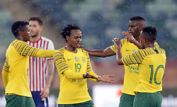 20112018 (Durban)<br /> A goalscorer Percy Tau celebrates during a mactch were Bafana Bafana and Paraguay have drawn 1-1 in the Nelson Mandela Challenge match played at Moses Mabhida Stadium in Durban on Tuesday evening.<br /> Picture: Motshwari Mofokeng/African News Agency (ANA)