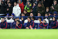 Ryan Giggs, the Manchester United Coach, Louis van Gaal, the Manchester United Manager and the rest of the management looking dejected after Diego Costa of Chelsea scores his teams 1st goal of the match to make it 1-1. Barclays Premier league match, Chelsea v Manchester Utd at Stamford Bridge in London on Sunday 7th February 2016.<br /> pic by John Patrick Fletcher, Andrew Orchard sports photography.