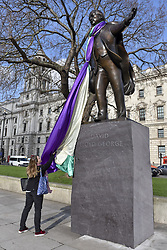 February 6, 2018 - London, UK - LONDON, UK. A banner in the colours of the suffragette movement has been placed on the statue of David Lloyd George in Parliament Square.  It is 100 years since the Representation of the People Act was passed, granting some women over the 30 in the UK the right to vote for the first time but David Lloyd George was the Chancellor of the Exchequer who, at the time, opposed women getting the vote. (Credit Image: © Stephen Chung/London News Pictures via ZUMA Wire)