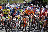 Kate Courtney (USA) in the mix during the start of the Cross Country Olympics event at the 2018 UCI MTB World Championships - Lenzerheide, Switzerland