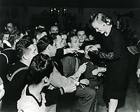 1944 Faye Emerson signing autographs at the Hollywood Canteen