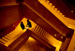 Stock photo of two businessmen talking in a stairway