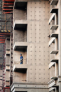 "A worker mans a drill at an unfinished apartment  complex in Shanghai, China on 29 December, 2009.  China has tightened land-sale regulations for developers in its latest attempt to take some of the steam out of the potentially overheating property market, this followed a recent vow from Beijing last week to curb what it calls an ""overly fast"" rise in property prices by boosting the supply of cheap public housing and redeveloping slum areas.."