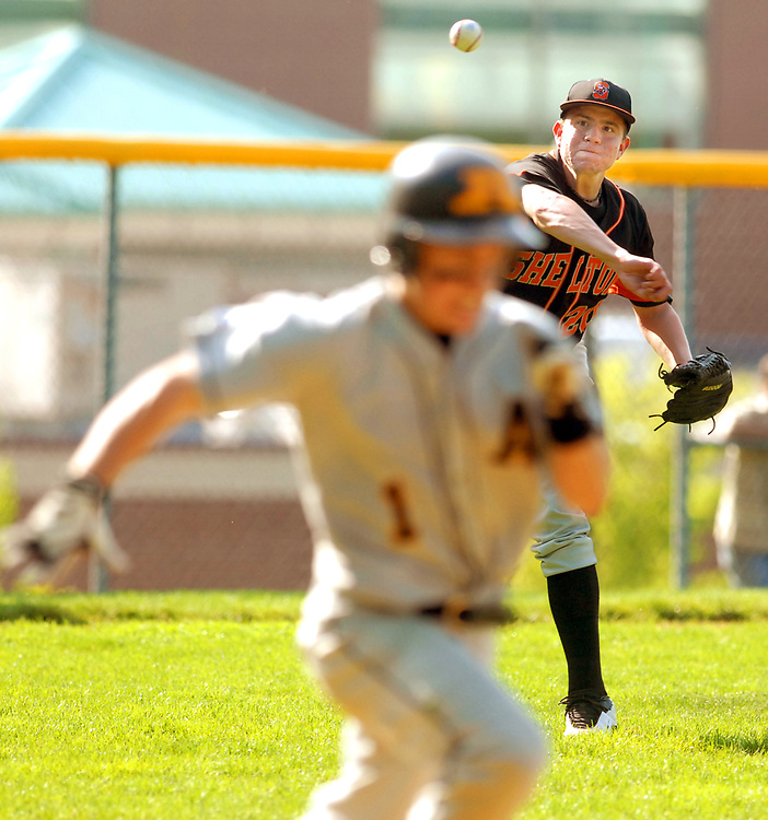 5/15/09 3Baseball<br /> ML0545F<br /> Shelton at Amity Baseball, 4th inning: Shelton's pitcher Peter Jay fires the ball to first base getting out Amity's Brian Kernan. Photo by Mara Lavitt