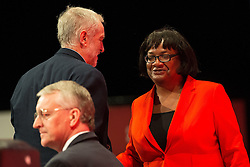 © Licensed to London News Pictures . 28/09/2015 . Brighton , UK . JEREMY CORBYN kisses DIANE ABBOTT after Abbott speaks at the 2015 Labour Party Conference . Photo credit : Joel Goodman/LNP