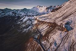 THEMENBILD - Blick auf die Strasse mit den Schnee bedeckten Bergen in der Morgensonne. Fuscherlacke, Mittertoerl, Hochtor. Die Grossglockner Hochalpenstrasse verbindet die beiden Bundeslaender Salzburg und Kaernten und ist als Erlebnisstrasse vorrangig von touristischer Bedeutung, aufgenommen am 11. September 2019 in Fusch a. d. Grossglocknerstrasse, Österreich // View on the road with the snow covered mountains in the morning sun, Fuscherlacke, Mittertoerl, Hochtor. The Grossglockner High Alpine Road connects the two provinces of Salzburg and Carinthia and is as an adventure road priority of tourist interest, Fusch a. d. Grossglocknerstrasse, Austria on 2019/09/11. EXPA Pictures © 2019, PhotoCredit: EXPA/ JFK