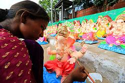 August 22, 2017 - Jaipur, India - An Indian woman artist giving final touch to Idols of elephant headed Hindu god Ganesh ahead of Ganesh Chaturthi festival in Jaipur ,Rajasthan , India on 22 Aug,2017. (Credit Image: © Vishal Bhatnagar/NurPhoto via ZUMA Press)