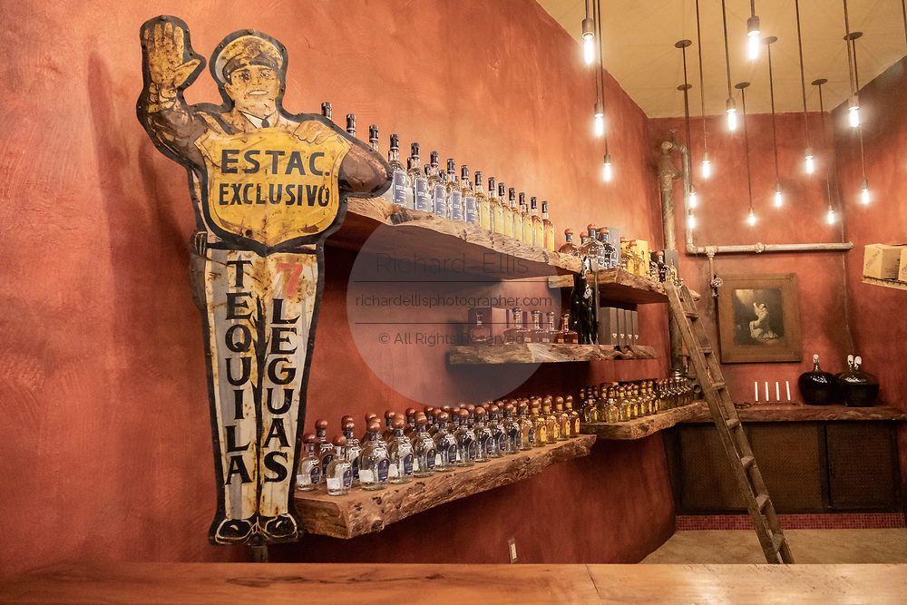 The tasting room inside the Casa Siete Leguas, El Centenario tequila distillery in Atotonilco de Alto, Jalisco, Mexico. The tequila is aged from 2-12 years in white oak barrels that once held American Kentucky Bourbon. The Seven Leagues tequila distillery is the oldest family owned distillery producing authentic handcrafted tequila using traditional methods.