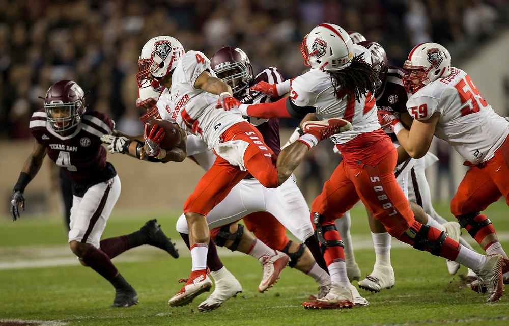 New Mexico running back Romell Jordan (4) tries to turn the corner against Texas A&M during the first quarter of an NCAA college football game on Saturday, Nov. 11, 2017, in College Station, Texas. (AP Photo/Sam Craft)