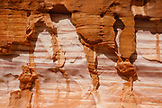 """Rock patterns along the White Domes Loop Trail in Valley of Fire State Park, near the town of Moapa Valley, Nevada, USA. A great 3.5-mile """"spectacle loop"""" (with 450 feet of gain and loss) starts at Park Turnout #3, goes to the Fire Wave, proceeds along the Seven Wonders Trail through Kaolin Wash, completes the White Domes Trail Loop back to the movie set remains, repeats a quarter mile of Kaolin Wash, turns north on Seven Wonders Trail past Thunderstorm Arch, and returns to Park Turnout #3. Starting more than 150 million years ago, great shifting sand dunes during the age of dinosaurs were compressed, uplifting, faulted, and eroded to form the park's fiery red sandstone formations."""