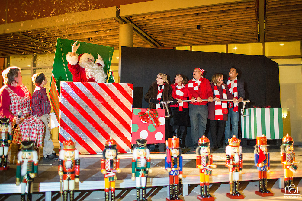 Milpitas dignitaries watch as Santa Claus pops out of a box and the Christmas Lights turn on during the Christmas Tree Lighting Ceremony at the Milpitas City Hall's Civic Center in Milpitas, California, on November 30, 2015. (Stan Olszewski/SOSKIphoto)