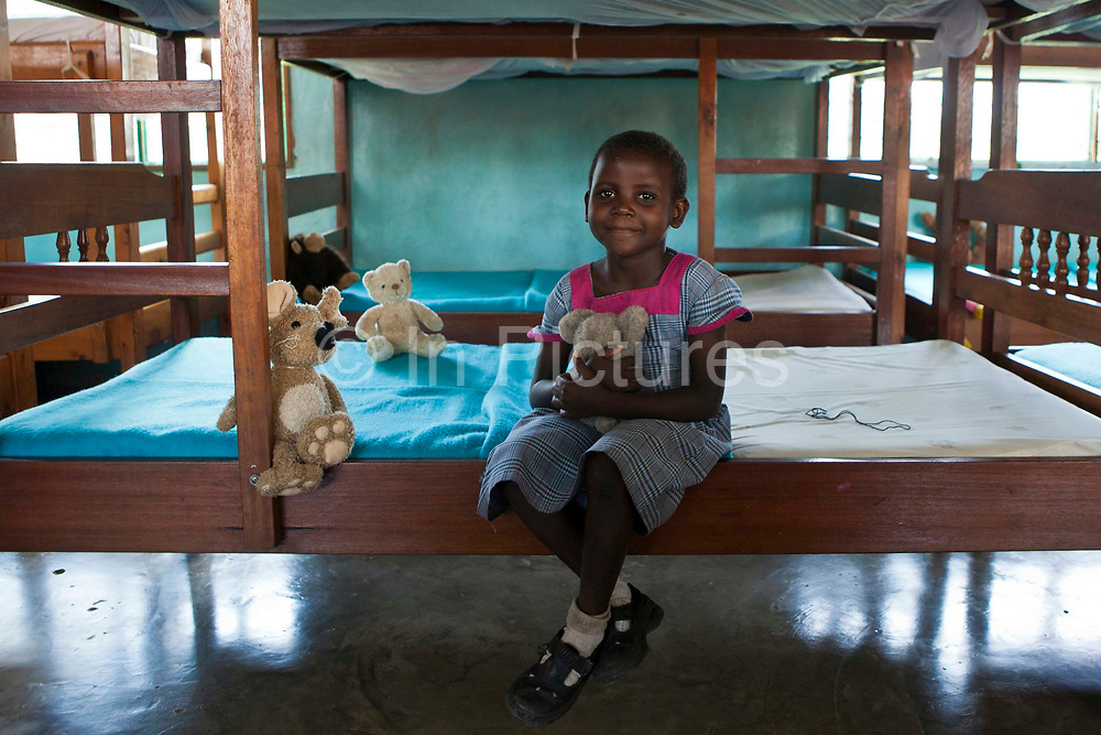 Mary who is 6 and a half, lives at the Wema centre for girls. She was rescued from the streets and now attends school and has a safe and secure life. Her sister Evelyn also came through the centre. Wema is an NGO organisation supporting vulnerable children.