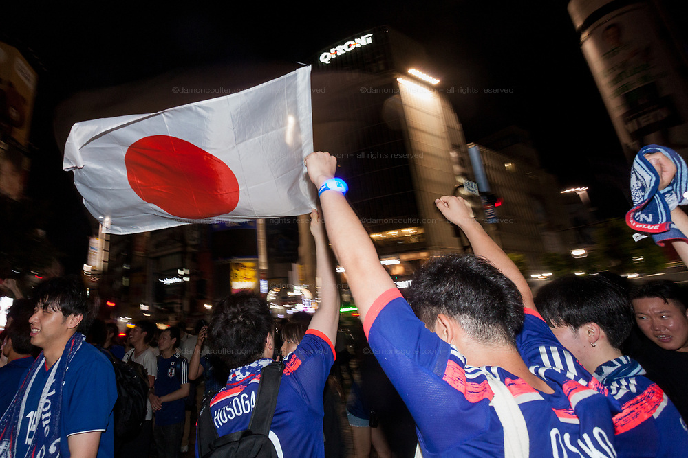 Soccer fans celebrate the Japan National Team qualifying for the next round of the 2018 World Cup in Russia. Shibuya, Tokyo, Japan Friday June 29th 2018. Japan lost to Poland  0-1 but managed to move to the next stage on points. Thousands of younger fans gathered at Tokyo's iconic Shibuya crossing to enjoy the moment with police controlling the crowds