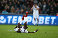 Tammy Abraham of Swansea city lies on the ground after taking a knock. Premier league match, Swansea city v Crystal Palace at the Liberty Stadium in Swansea, South Wales on Saturday 23rd December 2017.<br /> pic by  Andrew Orchard, Andrew Orchard sports photography.