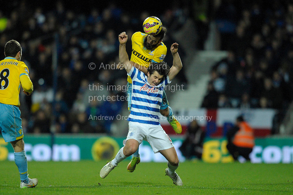 Joe Ledley of Crystal Palace heads the ball over Joey Barton, the QPR captain. Barclays Premier league match, Queens Park Rangers v Crystal Palace at Loftus Road in London on Sunday 28th December 2014.<br /> pic by John Patrick Fletcher, Andrew Orchard sports photography.