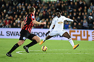 Wilfried Bony of Swansea city has a shot at goal. Barclays Premier league match, Swansea city v Queens Park Rangers at the Liberty stadium in Swansea, South Wales on Tuesday 2nd December 2014<br /> pic by Andrew Orchard, Andrew Orchard sports photography.