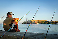 Boy sitting with fishing rod