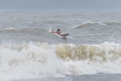 October 7, 2016 - Isle Of Palms, United States - A surfer waits for a wave to ride as Hurricane Matthew approaches the coast churning up the Atlantic Ocean October 7, 2016 in Isle of Palms, South Carolina. The hurricane is expected to make landfall near Charleston as a Category 2 storm with strong winds, rain and storm serge. (Credit Image: © Richard Ellis via ZUMA Wire)
