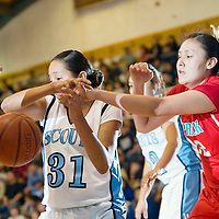 010812  Adron Gardner<br /> <br /> Window Rock Scout Arianne Sheka (31) has possession knocked away by Shiprock Chieftain Chiashonya Nelson (42) in Fort Defiance Tuesday.