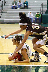 17 December 2011:  Olivia Lett captures a loose ball and keeps it from Ashley Teresiak during an NCAA womens division 3 basketball game between the St. Francis Fighting Saints and the Illinois Wesleyan Titans in Shirk Center, Bloomington IL