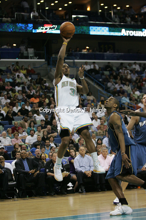 Hornets guard Chris Paul shoots against the Washington Wizards on February 25, 2008 at the New Orleans Arena in New Orleans, Louisiana. The New Orleans Hornets lost 95-92 to the Washington Wizards.
