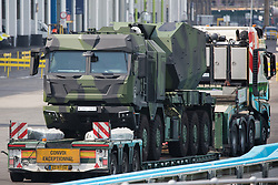 London, UK. 6th September, 2021. A military vehicle is pictured on a trailer in a holding area outside ExCeL London as preparations for the DSEI 2021 arms fair take place. The first day of week-long Stop The Arms Fair protests outside the venue for one of the world's largest arms fairs was hosted by activists calling for a ban on UK arms exports to Israel.