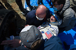 Expedition 62 crew member Andrew Morgan of NASA is helped out of the Soyuz MS-15 spacecraft just minutes after he, Roscosmos cosmonaut Oleg Skripochka, and NASA astronaut Jessica Meir, landed in a remote area near the town of Zhezkazgan, Kazakhstan on Friday, April 17, 2020. Meir and Skripochka returned after 205 days in space, and Morgan after 272 days in space. All three served as Expedition 60-61-62 crew members onboard the International Space Station.<br /> <br /> Where: Zhezkazgan, Kazakhstan<br /> When: 17 Apr 2020<br /> Credit: NASA/GCTC/Andrey Shelepin/Cover Images<br /> <br /> **Editorial use only**