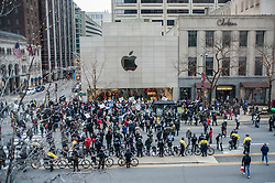 "© Licensed to London News Pictures. 24/12/2015. Chicago, USA. Hundreds of people gather to march down Michigan Avenue's ""Magnificent Mile"" shopping district on Christmas Eve to protest against the alleged police cover up related to the fatal shooting of Laquand McDonald by a Chicago policeman.  Flanked by members of the Chicago police force, protestors were chanting ""16 shots and a cover up,"" and calling for Chicago Mayor Rahm Emanuel to resign, on what was described as ""Black Christmas"".  Major stores, such as the Apple store, pictured, were targeted for demonstrations outside to disrupt last minute Christmas shoppers.  Photo credit : Stephen Chung/LNP"