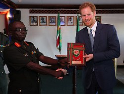 Prince Harry receives a gift during a visit to Camp Ayanganna, the headquarters of the Guyana Defence Force, in Georgetown, Guyana, after arriving in the South American country on the final stop of his 15-day tour of the Caribbean.