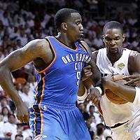 19 June 2012: Miami Heat power forward Chris Bosh (1) drives past Oklahoma City Thunder center Kendrick Perkins (5) during the third quarter of Game 4 of the 2012 NBA Finals, Thunder at Heat, at the AmericanAirlinesArena, Miami, Florida, USA.